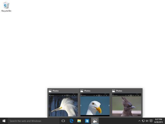 Ponto em um ícone da barra de tarefas para ver seus programas atualmente em execução.